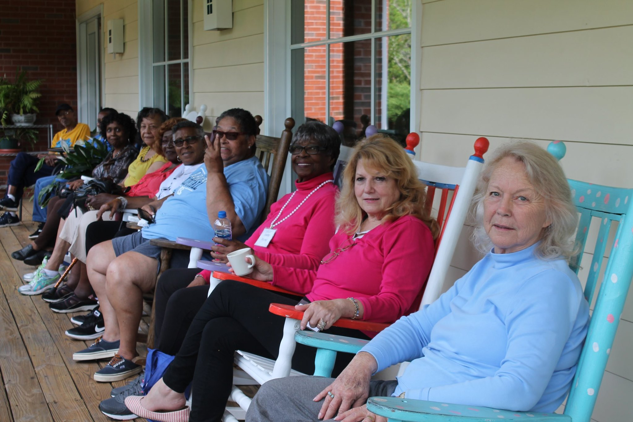 photo of a women at the Council on Aging Senior Center sitting in rocking chairs