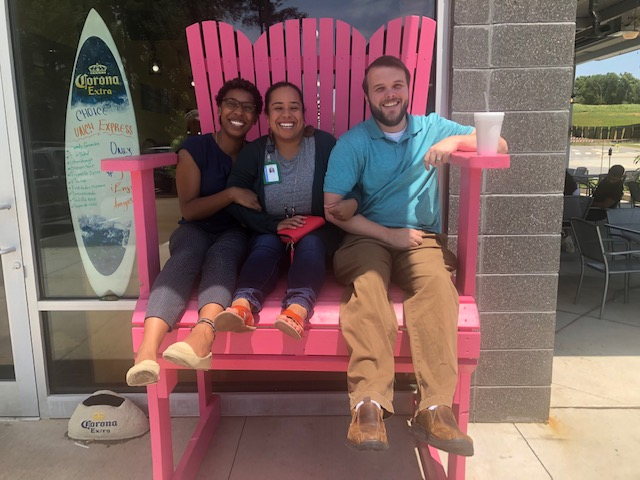 picture of me, Stephanie, and Darrell in a giant chair at lunch